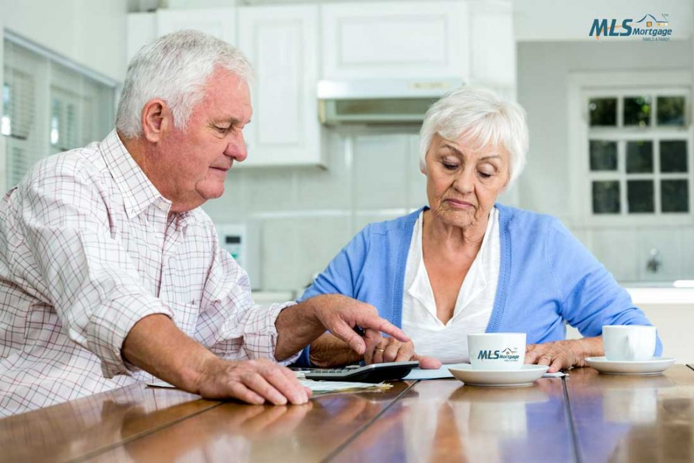 Couple reviewing pros and cons of a reverse mortgage